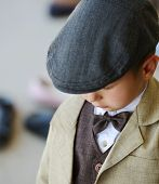 Little cute boy wearing retro suit and hat