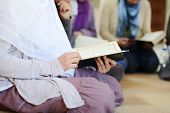 stock photo of muslimah  - Muslim and Arabic girls reading Koran together in group - JPG