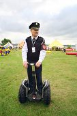 MOSCOW - AUGUST 18: Security guard on Segway at festival Ekofest 2012 on banks of Stroginsky gulf, o
