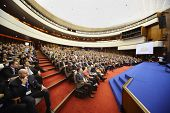 MOSCOW - NOVEMBER 14: People listen speaker at Forum Small Business - New Economy, dedicated to 10th