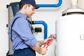 pic of pipefitter  - Technician servicing an hot - JPG