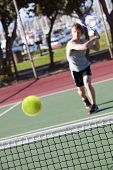 Man playing tennis - focus on ball