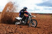 stock photo of dirt-bike  - Off road motorbike driving in dirt - JPG