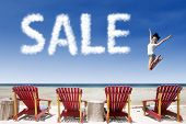 stock photo of beside  - Sale cloud over beach chairs with woman beside the word - JPG