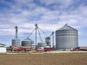 stock photo of silos  - Agricultural grain elevator building for corn storage in silos - JPG