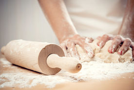 foto of pastry chef  - Woman kneading dough for bread or cookies, close-up photo