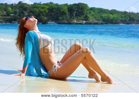 Brunette Girl Relaxing On The Beach