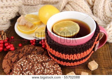 Cup of tea with lemon on wooden table