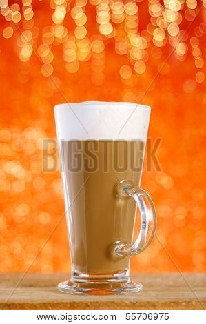 coffee latte with red glitter backdrop, shallow dof