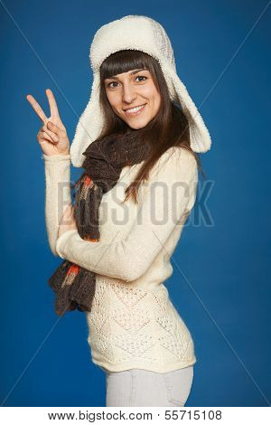 Winter girl showing victory sign