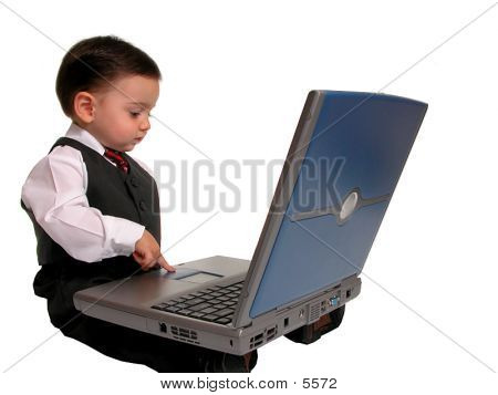 Boy Child In Business Suit On Laptop Side View