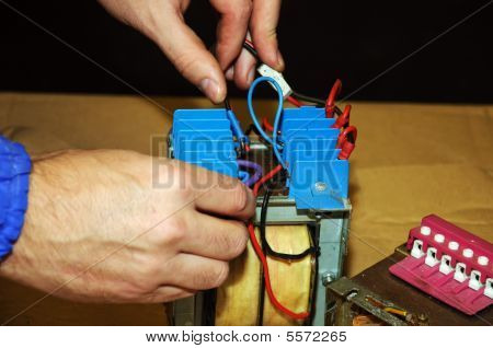 Picture Of Male Working On Electrical Transformer