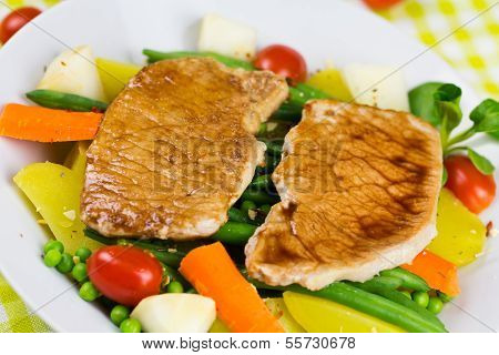 Grilled Cutlet Food , mixed with colorful vegetable