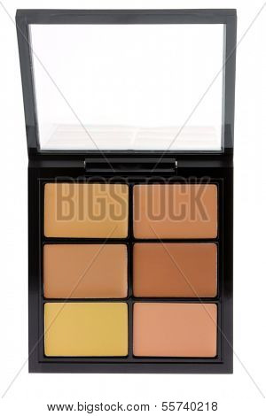 Closeup photo of a concealer palette to conceal under-eye circles or facial blemishes, isolated on white