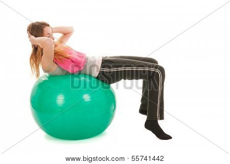 Sport woman with ball training the abs isolated over white background