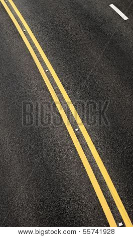 Blacktop With Double Yellow Line Divider Vertical