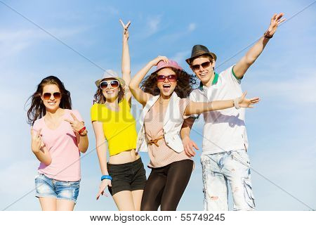 Young happy people having fun outside in summer