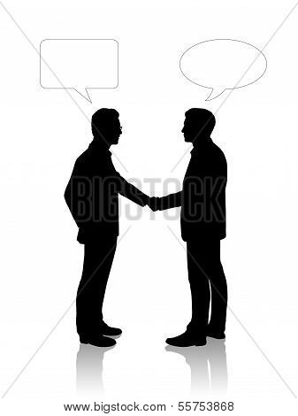 Two Young Businessmen Shaking Their Hands