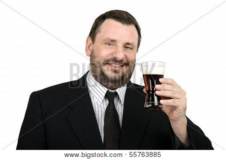 Mature Man In Suit With Glass Of Ale