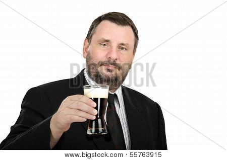 Caucasian Man In Black Suit With Ale Glass
