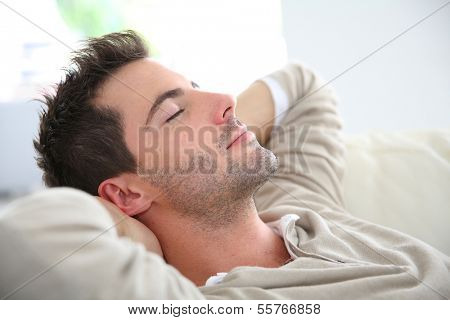 Man taking a nap in sofa