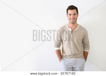 Handsome guy standing on white background