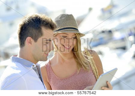 Couple looking at tourist information on tablet