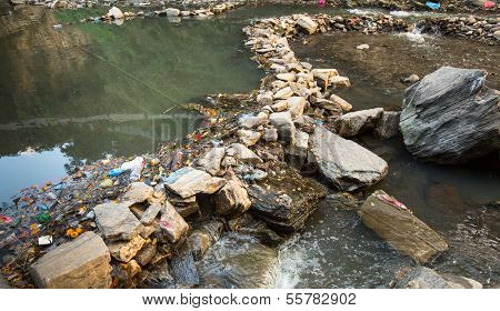 Environmental problems. Plastic Contamination into Nature. Garbage and bottles floating on water.