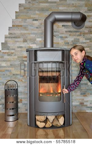 Child Opening Wood Fired Stove