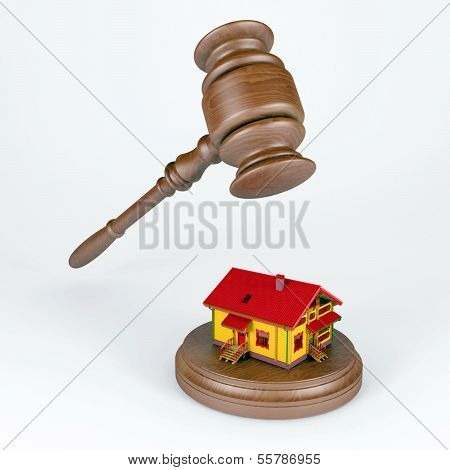 wooden gavel over the house