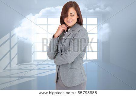 Thoughtful businesswoman against room with holographic cloud