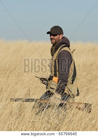 Hunter in tall grass
