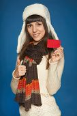 Winter woman holding credit card