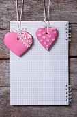 Two Pink Heart Cookies And A Note On A Wooden Board