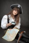 picture of crossed pistols  - Pirate girl with sea map and pistol sit on a black background - JPG