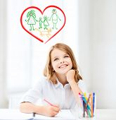 education, creation and school concept - smiling little student girl drawing and daydreaming at scho