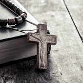 foto of scriptures  - wooden cross on a wooden surface closeup - JPG