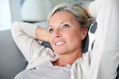 foto of stressless  - Portrait of mature attractive woman relaxing at home - JPG