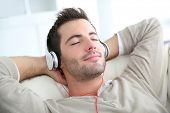 pic of single man  - Young man listening to music with headphones - JPG