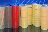 stock photo of gaffer tape  - Big piles of sticky packing and gaffer tapes for office - JPG