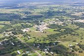 stock photo of land development  - A mix of farmland roads buildings and jungle creates a unique landscape on the flat land of the Cayo District in Belize - JPG