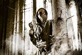 stock photo of chemical weapon  - A soldier wearing gas mask is fighting in the forest - JPG