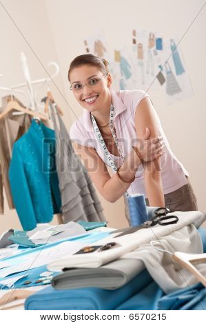 Female Fashion Designer Working At Studio