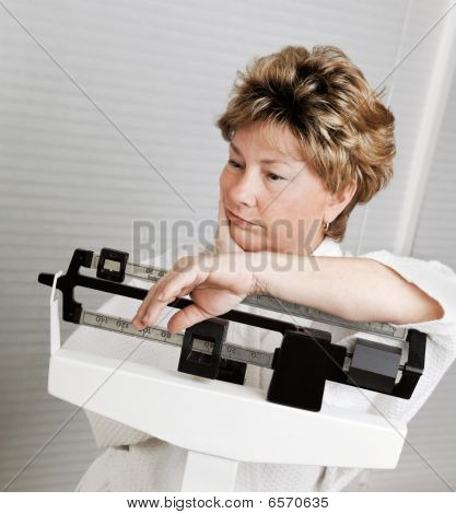 Mature Woman On Weight Scale