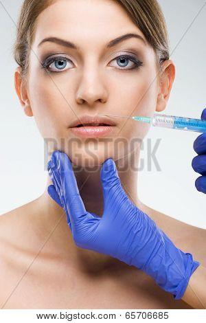 Beautiful flawless female face - plastic surgery lip augmentation
