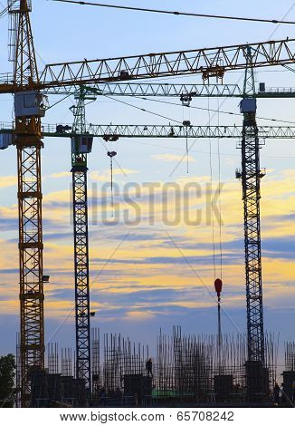 Crane Of Building Construction Against Beautiful Dusky Sky Use For Construction Industry Business An