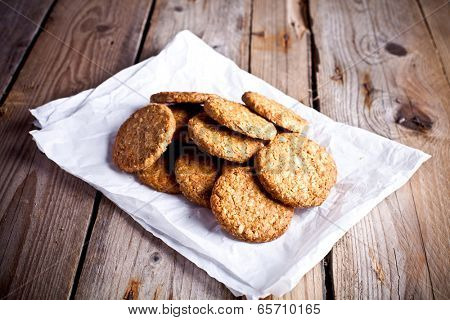 fresh crispy oat cookies on rustic wooden table
