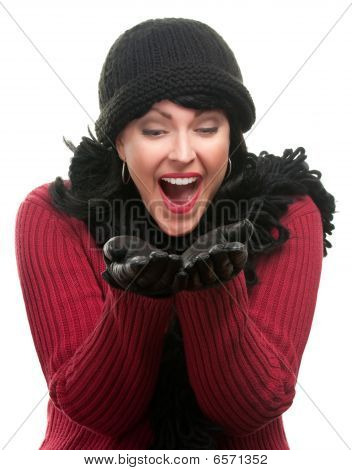 Excited Woman In Winter Clothes Holds Her Hands Out