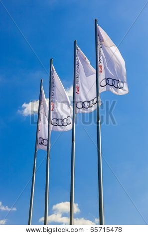 Samara, Russia - May 24, 2014: The Flags Of Audi Over Blue Sky. Audi Ag Is A German Automobile Manuf