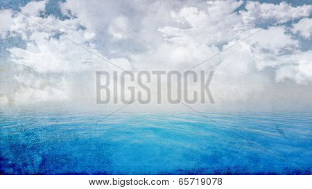 3D render of a grunge style blue ocean and fluffy white clouds in sky